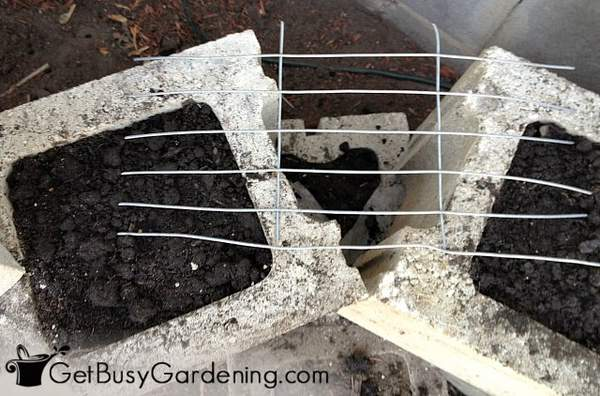 Wire support over planter block corners to hold the soil in