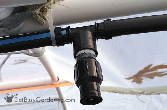 Easy overhead greenhouse sprinkler installation using zip ties