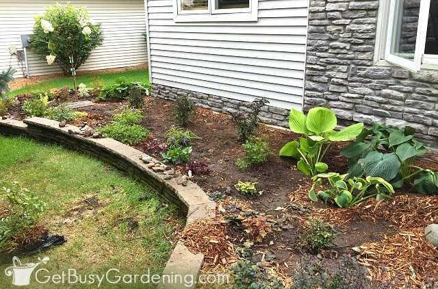 Done planting flower beds in front of the house