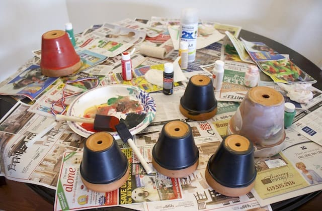 Painting clay pots with acrylic paint