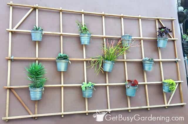 Hanging pots make unique types of vertical garden systems