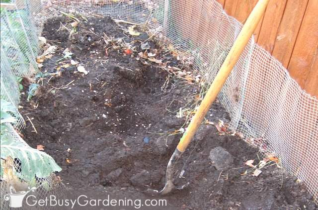 Turning the compost in my larger DIY bin