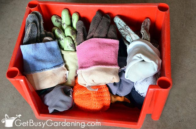 Neatly organized garden gloves in a container