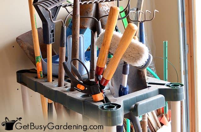 Storage rack for long handled garden tools